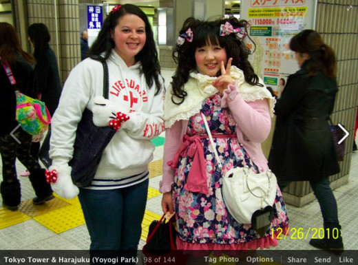 "A Japanese ""doll"" and myself in the Harajuku train station."