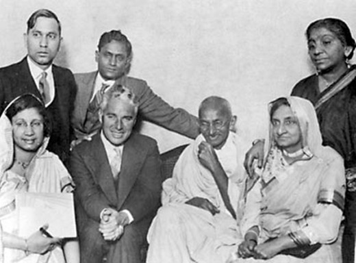 Charlie Chaplin  with Gandhi in a group photo. (Siting, left to Gandhi)