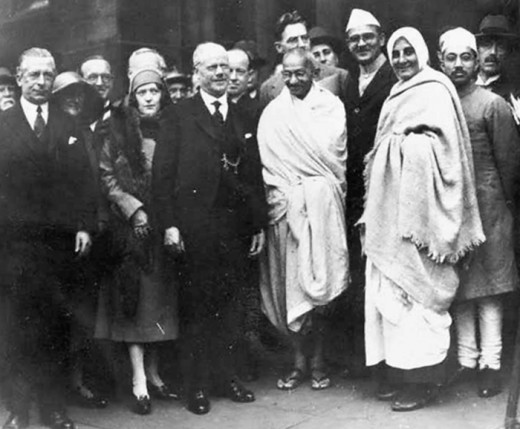 Gandhi with his British disciple Miraben (Madeleine Slade) (right), and others.