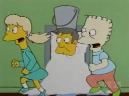 Seymour Skinner with pee bucket on head.