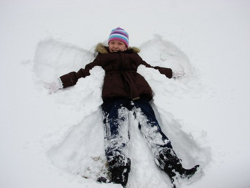 Snow angel making wings in the snow.