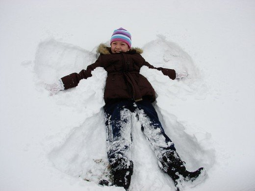 Snow angel makes wings in the snow.