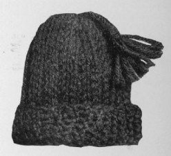 """This is a cap made from spool weaving """"snakes"""" sewn together with matching yarn."""