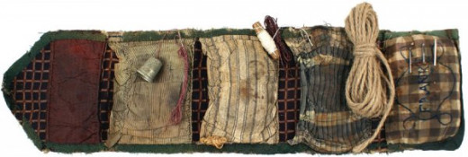 "A ""housewife"" - a sewing kit carried by many troops in the war in order to mend their clothing"