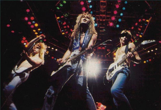 Steve Clark, Rick Savage and Phil Collen preform live during the band's Hysteria tour.