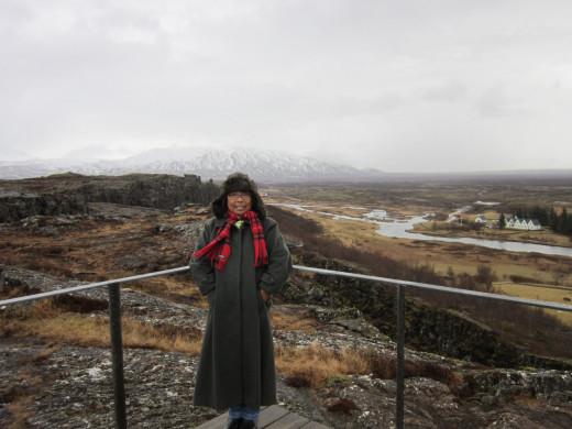 Standing literally in No Man's Land.Behind me is the American side of the tectonic plates which geologically cuts the earth into two.The other side is the Eurasian tectonic plate.Both plates recede about 2.5 centimeters a year