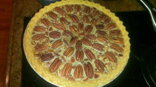 how pie should look right before putting into the oven (after arranging pecans in a decorative pattern)