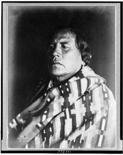 Curly (1859-1923), survivor of Custer massacre–Crow Indian scout for Custer, head-and-shoulders portrait, facing left.  c. 1907