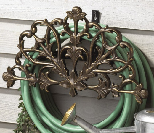 Storage Option for your garden Hose decorative iron mounted on the side of your home