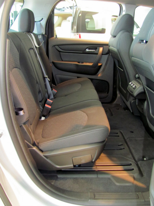 Acadia's second row rear seat slides fore/aft for comfort and folds forward to allow easy access to third row rear seat.