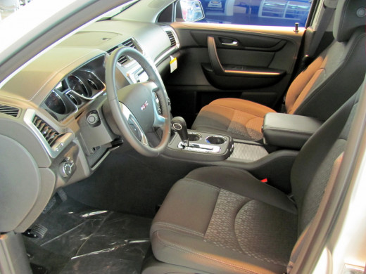 Driver's area is roomy and comfortable, with adjustable bucket seats and tilt/telescope steering wheel