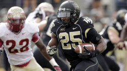 Wake Forest tailback Josh Harris (Wake Forest new black matte helmet)