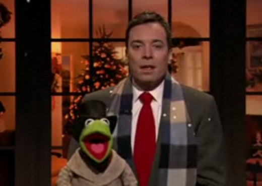 Pictured: Kermit the Frog with puppet wrangler.