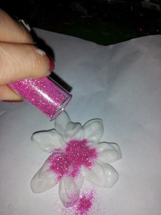 Pour glitter over flower