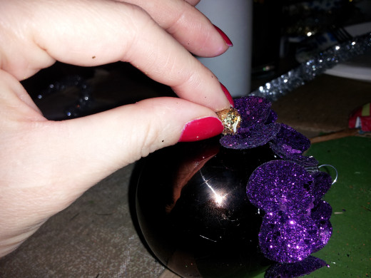 glue glittered ball in middle of leaves
