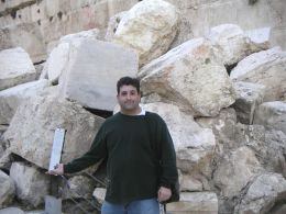 Ross stands by the temple ruins in the Old City, Israel.