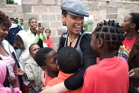 Alicia Keys volunteering in Africa with her Keep a Child Alive foundation to help end AIDS.