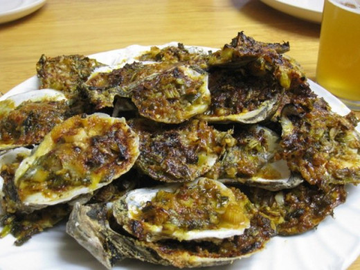 Grilled oysters topped with cheese and herbs is the perfect combination. See two great recipes here.