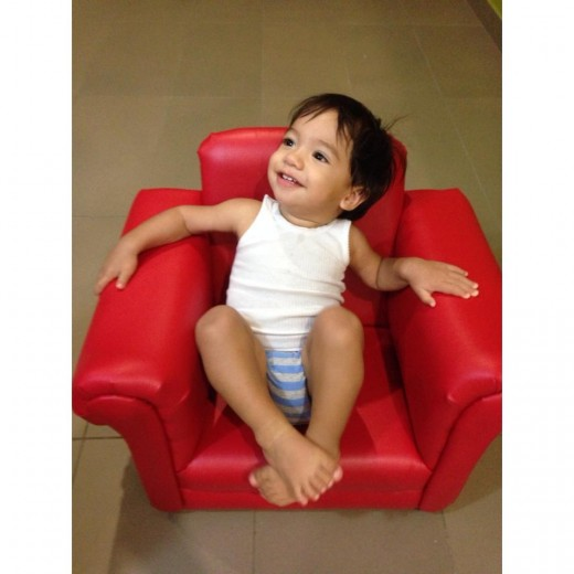 Taidan chill in' in his red chair.