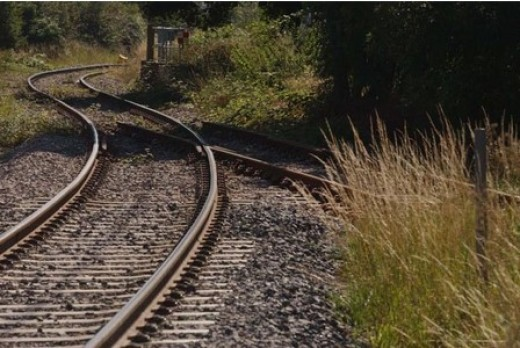 This could be anywhere, on any branchline, partly overgrown, maintained only up to freight or slow running (20mph), light railway standards
