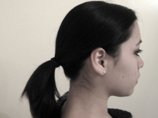 A lower ponytail is better so you have more room to bump!