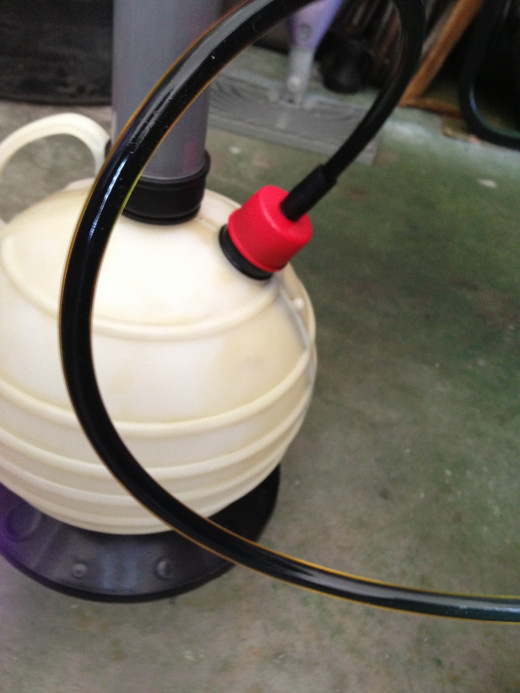 Oil turns dark when used. If its flowing freely through the hose, the color shouldn't concern you – oil can look like this after 500-to-1,000-miles.