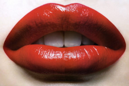 Red lips are the quintessential symbol & archetype of allure & seduction.  Nothing says it better. Red lips are used to sell everything from records and movies to t-shirts. Red lips are also enduring symbols of glamor & sophistication.