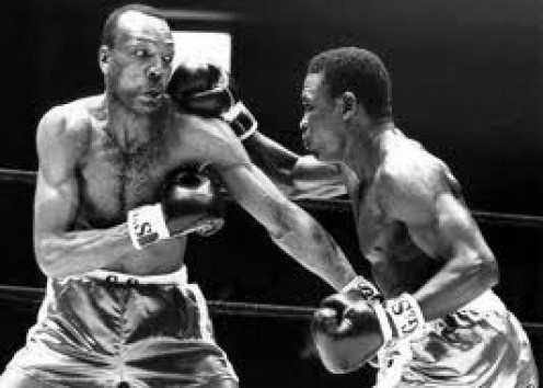 Bob Foster, left, destroyed Dick Tiger to win the middleweight championship of the world.