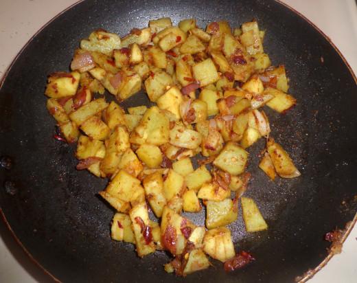Sauteed Tasty Spicy sweet potato cubes