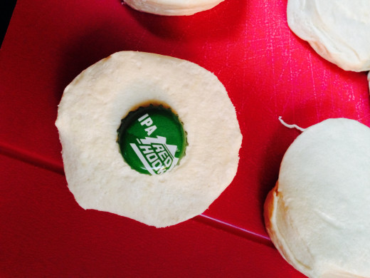 Beer bottle caps are perfect for jumbo biscuits.  IPA's are preferred.  You can substitute your favorite beer style, the doughnuts just won't be as good.