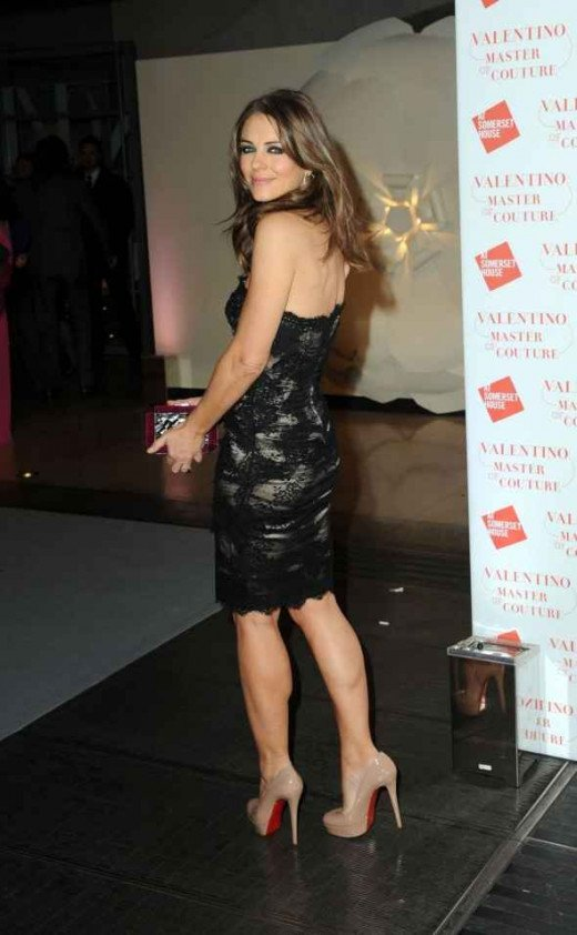 Elizabeth Hurley in a lace little black strapless dress and Louboutin heels