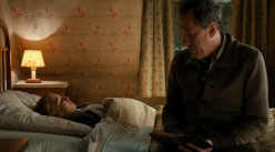 Papa comforts Liesel after a nightmare and discovers Liesel's book and that she cannot read.