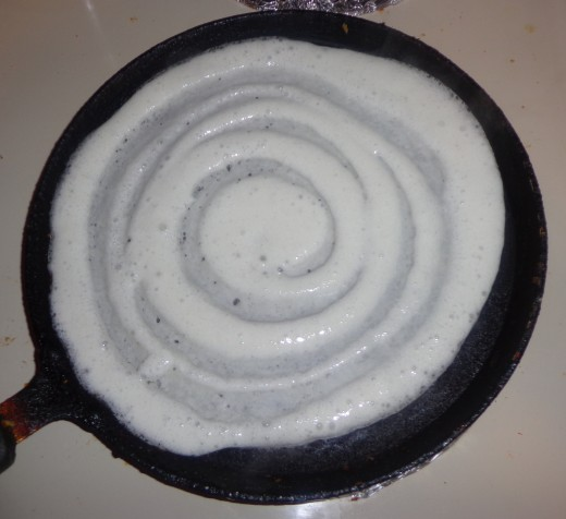 Drizzle oil in and across the dosa