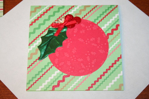 Fold the edges of the paper around each side of the card.