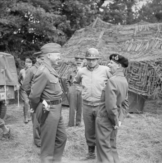 General Montgomery with Generals Patton and Bradley at 21st Army Group HQ, 7 July 1944. Despite the smiles the relationship with Montgomery was never easy.