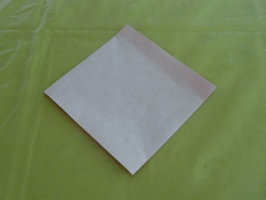Position the origami paper this way with the white side facing up.