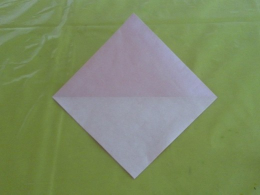 Unfold the paper and you will see a horizontal crease line.