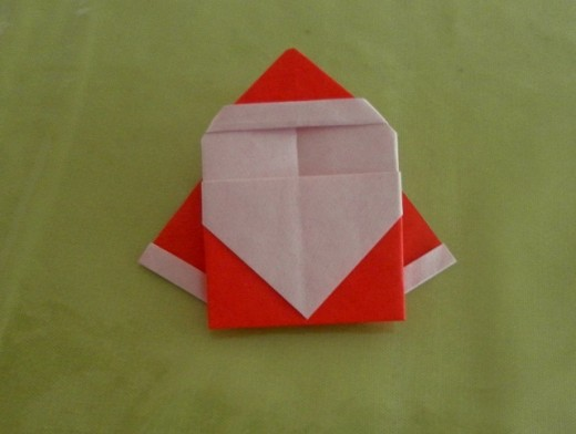 Turn the folded paper over and you see a faceless santa looking at you!