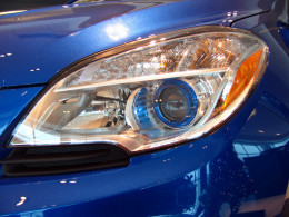 Halogen composite projector beam headlamps with blue translucent ring mirrors the interior ambient lighting accent