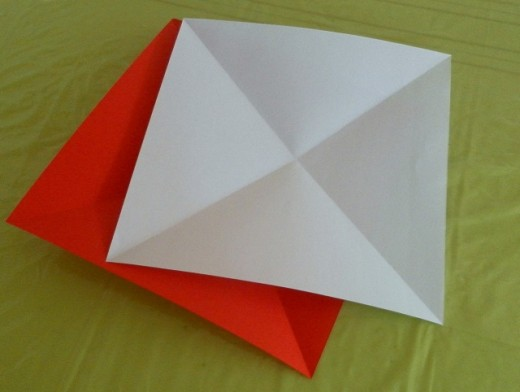 Cut the papers to squares, align the two sheets together and follow the folding instructions outlined above.