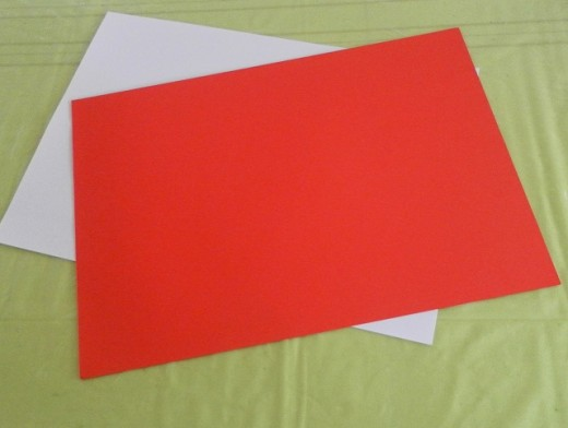 To make a Santa ornament for the Christmas tree, use 2 sheets of A4 paper, one red and one white.