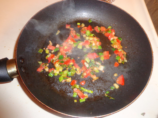 When the onions are fried, tomatoes are added  in the pan for frying.
