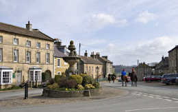 Middleham Square, where roads diverge, beyond the horses to Masham and Ripon, to the left from the fountain in the direction of Leyburn and Wensley, behind the photographer to Coverdale and Kettlewell in Upper Wharfedale.