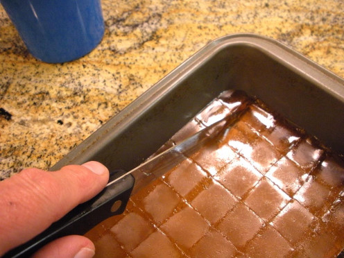 Once firmly set, cut candy into small squares; you'll need to keep re-dipping the knife in the hot water.