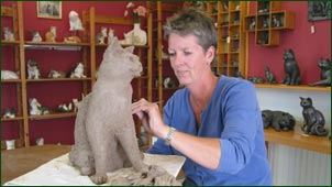 Moorside Design Cat Pottery - open the glass door, walk up the path to the workshop and you'll probably find Sarah here, at work on one of her creations. Look around at the other cats - real and earthen - and take your choice of the earthen ones