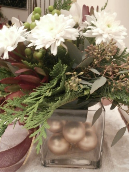 Ornaments used to fill up spaces in a container., adding another element of charm.
