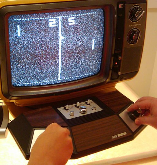 """Dave and I play """"Pong"""" on my cousins' Atari during our visit."""