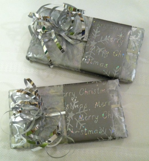 "Silver printed tissue paper under a sleeve of silver foil paper that says ""Merry Christmas"" will greet friends quite nicely."