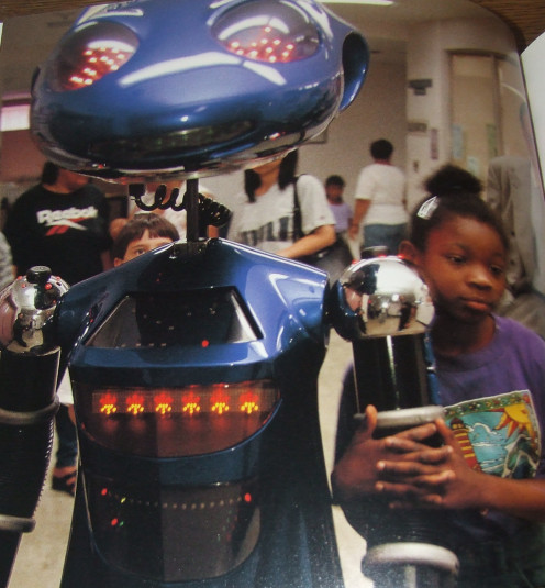 Fovenor Hospital 11-year old Jamie Quinones takes a walk with robot SICO.