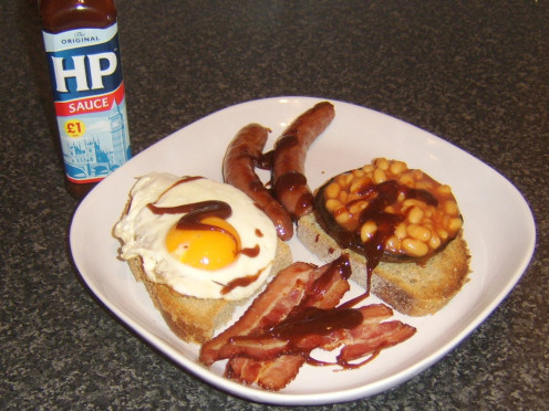 Beans on toast with sausage, bacon , egg and HP Sauce